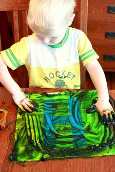 Finger Painting for Toddlers to Make Tape Resist Art