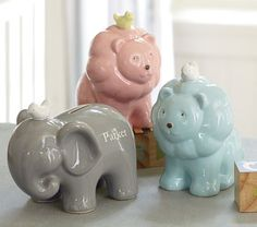"Ceramic ""piggy"" Bank. Need one in the gray elephant design. $29. Only complaint: the feet are hollow, so change can get stuck in them."