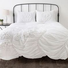 gorgeous bedding with simple iron bed