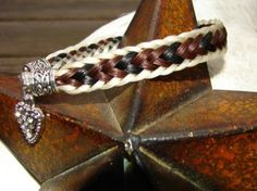 Tangled Tails by Pony Gurl  Horsehair jewelry.    Amazing gifts made from your horse's tail.