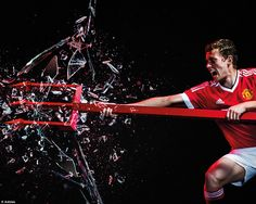 James Wilson poses in the newly-released retro-looking kit which may have some United supp...