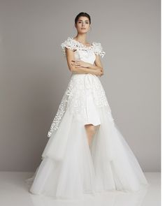 Extravagant mullet wedding dress in A-line tiered tulle skirt and top union of Giuseppe Papini