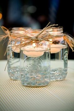 Mason Jars and Candles Keep it simple and use floating candles as your centerpiece. They'll glisten in clear Mason jars. Mason Jars and Candles Keep it simple and use floating… Party Planning, Wedding Planning, Dream Wedding, Wedding Day, Trendy Wedding, Wedding Simple, Wedding Rustic, Wedding Signs, Wedding Stuff