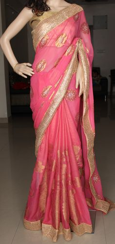 Light weight elegant party wear saree in pink. Shimmer georgette with self woven beaitiful zari design in pleats and georgette with gold zari butis embelished with stones and pearls in pallu. Whole saree is decorated with gold lace  Blouse: Gold jute fabric  Contact us at askbhama@gmail.com or whatsapp 9010396655 for bookings and details