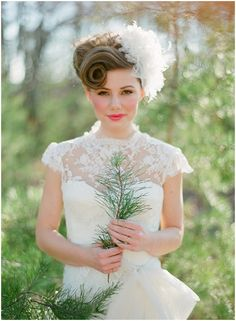 Her hair is the perfect 50's style wedding updo!! Ah I love it!