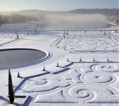 The Palace of Versailles gardens in the snow. Beautiful