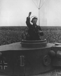 TANKS OF GERMANY - POWER AND STRENGTH.The commander of a Tiger from schwere Panzer-Abteilung 503 gives a hand and arm signal to tank commanders for them to initiate radio checks in August Kharkov region. Panzer Iii, Military Photos, Military History, Germany Ww2, Military Armor, Tiger Tank, Ww2 Photos, Ww2 Tanks, Armored Vehicles