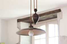 The French House Aged Brass Rise and Fall Light Fitting