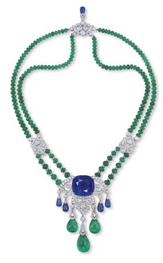 A SAPPHIRE, EMERALD AND DIAMOND PENDENT NECKLACE:BROOCH, BY CARTIER
