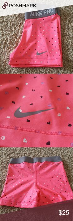 Nike pro spandex shorts 3 inch Nike shorts. Pink, black, white, gray, and possibly a lavender color in the square dots. Cute! I just never wear them. Nike Shorts
