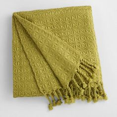 Soft and sumptuous with hand-twisted diamond fringe, our exclusive green throw blanket brings a plush pop of color to the bedroom or living room.