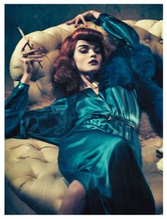 Model Crystal Renn as a redhead wearing a teal dress. Photograph by Sebastian Kim for Vogue Germany, October 2011.