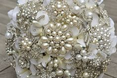 oh. my. gawd. i want one of these GORGEOUS jewelled wedding bouquets. and i'm already married! LOL you absolutely MUST check them all out....