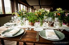 Tuscan rustic centerpiece idea: Wild flower arrangement with sage colored chargers as accents.