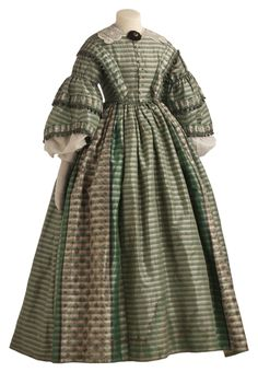 Striped silk day dress with ikat floral panels, ball fringe trim and mille fleur glass buttons. Completely hand-stitched. Worn by Frances Hanson Ordway, circa 1859-1862. Via http://collections.mnhs.org/.