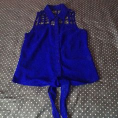 Royal Blue Caged Top Cute caged top with stings to tie in front. Charlotte Russe Tops Crop Tops