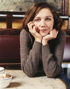 Maggie Gyllenhaal, displaying that forbidden aspect of the modern 'art photography portrait' - a smile!