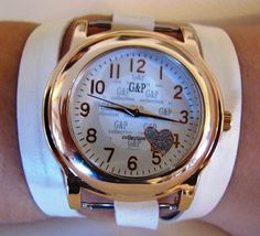 Adjustable, 2 snap, white,Large leather wrap Bracelet Watch. wraps around your wrist 3 times and easily snaps in the back. You can wear it tight or as a loose fitting bracelet.