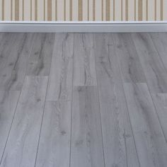 The elegant Grey Laminate Flooring from the Kronotex Farmhouse range recreates the charisma of a solid wood floor in a more affordable and easier to maintain product. The light neutral colour adds more versatility to the design, as this gorgeous laminate