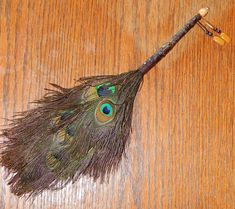 Hey, I found this really awesome Etsy listing at https://www.etsy.com/listing/232118445/feather-besom-broom-or-smudge-wand