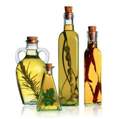 Infused olive oils are popular with herbs and other ingredients added after bottling. This changes colour tones and manipulates olive oil further but not in a deceptive or misleading way. Flavored Olive Oil, Flavored Oils, Infused Oils, Scented Oils, Olives, Olive Oil Bottles, Heart Healthy Recipes, Healthy Foods, Vegetarian Recipes