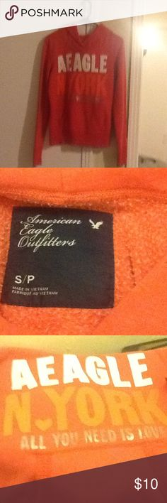 American eagle sweatshirt Orange sweatshirt says all you need it love very soft material has paint on it last picture American Eagle Outfitters Tops Sweatshirts & Hoodies