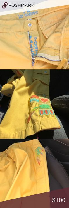 Johnny Was Capri pants Yellow with amazing embroidery details. Cargo pockets, back pockets, and side slot pockets. These are amazing!! Size medium. I am a 6-8 and they fit me. Johnny Was Pants Ankle & Cropped