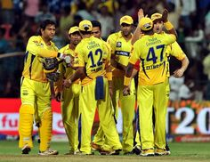 Chennai Super Kings captain M.S. Dhoni (L) and his teammates celebrate their victory against Mumbai Indians during the IPL Twenty20 cricket 2nd Playoff match at the M. Chinnaswamy Stadium in Bangalore on May 23, 2012.