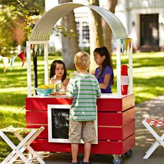 Build your kids the coolest lemonade stand on the block.  It's fully loaded with a chalkboard sign, awning, built-in cooler, and casters for easy transport. #DIY #summer