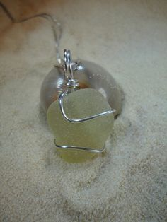 Pale yellow wire wrapped sea glass necklace by atreasurefromthesea, $17.99