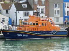 Weymouth RNLI LIfeboat (Ernest & Mabel) sitting in Weymouth Harbour