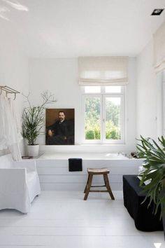 plants, art, and white modern decor