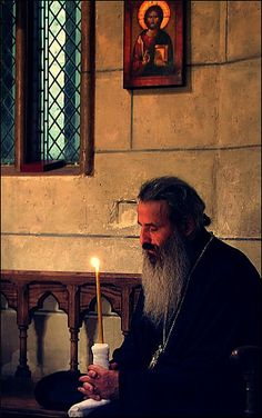romanian orthodox monk at prayer