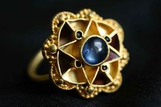 Experts baffled by magnificent gold and sapphire ring unearthed by metal detector