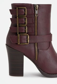 A faux leather bootie featuring multi-buckle accents, inner zip closure, and a faux stacked heel. ...