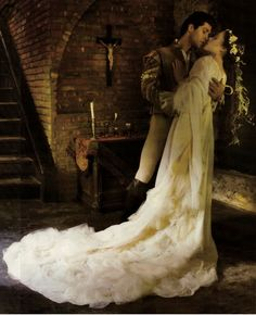 fairytale wedding, ethereal white bridal dress with long sheer ruffle trail, long brunette hair with cream flowers