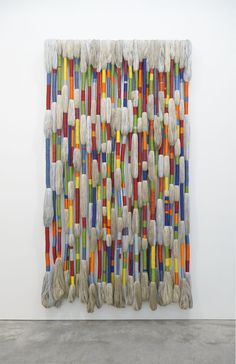 """Sheila Hicks,  Bâoli, 2014; natural, dyed, and bleached linen; synthetic metallic fiber; wrapped with linen and embroidery cotton; 114 x 63 x 8 inches; on view in """"Sheila Hicks,"""" a solo exhibition of new work, at Sikkema Jenkins & Co., New York, October 22 - November 28, 2015."""
