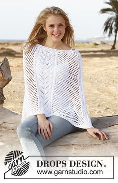 Knitted DROPS poncho with cables and lace pattern in Paris. Size: S - XXXL. Free pattern by DROPS Design.