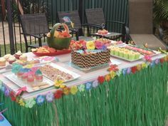 Having a luau-themed graduation party? Line the tables with grass skirts for an inexpensive, yet festive touch.