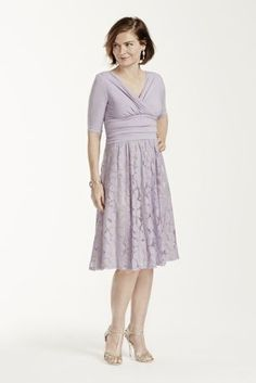 The display of mixing solids with prints makes this dress the perfect combination of elegant style and modern fashion!  3/4 sleeve bodice features a ruched, cross over V-neck shaping a stunning and slimming silhouette.  Knee length skirt has a sheer lace floral print design.  Available in Lilac. Skirt is fully lined.  Designed by Sangria. Imported poly/spandex/cotton/nylon blend. Hand wash cold.