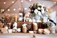 Cotton stuffed mason jars, Mason jars wrapped in twine, and birch wood give a rustic look. very cute