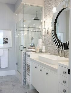 Tile in shower, mosaic above sink