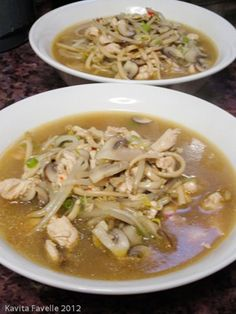 Japanese udon noodles and chicken in spicy soup