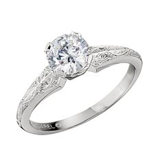 Solitaire Diamond engagement ring by Colonial Jewelers