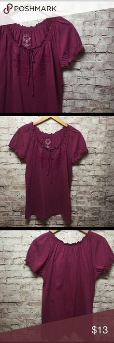 Sonoma Top Sonoma Top...it has a drawstring to close the neckline but leave just a peep to accent the front! Embroidered design on bust area. Small ruching elastic sleeves. Excellent condition! 60% cotton 40% modal 🌸 Color is like a light Merlot! 🌸 Sonoma Tops