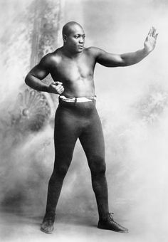 "John Arthur (""Jack"") Johnson (March 31, 1878 – June 10, 1946), nicknamed the ""Galveston Giant,"" was an American boxer. At the height of the Jim Crow era, Johnson became the first African American world heavyweight boxing champion (1908–1915). In a documentary about his life, Ken Burns notes, ""for more than thirteen years, Jack Johnson was the most famous and the most notorious African-American on Earth."" Johnson attests that his success in boxing came from the coaching he received from Joe Choynski, whom became his cellmate after the pair were arrested for fighting in Texas; where boxing was illegal at the time. The ageing Choynski saw natural talent and determination in Johnson and taught him the nuances of defence; stating A man who can move like you should never have to take a punch."