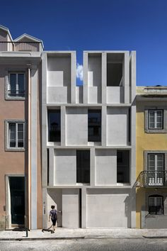 The concept for this house emerges from a reflection on the identity of Lisbon architecture, a recurring type  of 6-meter-wide and 15-meter-long deep house, ending in a small garden in the back. It is a 5-storey building with two radically different el...