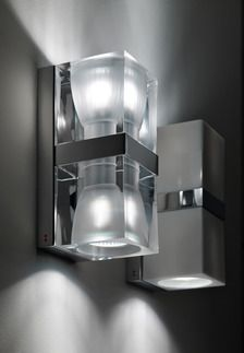 The Fabbian Cubetto 2-Light Wall Sconce shines elegant beams of illumination up and down a wall, the Crystal option made of 24% lead crystal. The shades have be