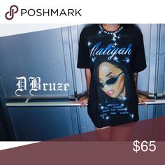 [Darien Bruze] •Aaliyah Air Brush Shirt• Amazing air brushed Aaliyah shirt by artist Darien Bruze. Gently worn, shirt is in good condition! More pictures and details soon! Shirt does not have a size tag. Looks like men's M-L. Small red specks on one area of the front (see last photo). Could easily be removed with a trip to the dry cleaners. Darien Bruze Tops Tees - Short Sleeve