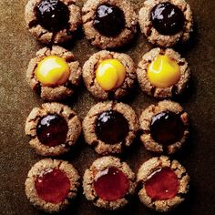 Roasted-Almond Thumbprints by Bon Appetit Magazine. The great thing about these roasted-almond thumbprint cookies? They can be any shape or size, and the fillings are customizable. Holiday Cookie Recipes, Holiday Cookies, Christmas Recipes, Cookie Tips, Cookie Swap, Christmas Treats, Holiday Treats, Holiday Gifts, Galletas Cookies